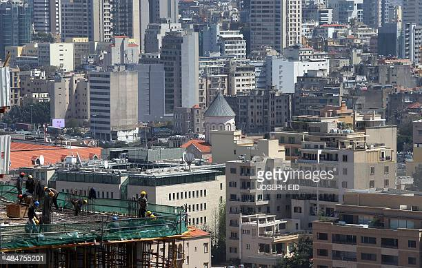 A partial view of Beirut's suburbs is seen from the Holiday Inn hotel in the Lebanese capital on April 11 as the nation marks 39years since the...