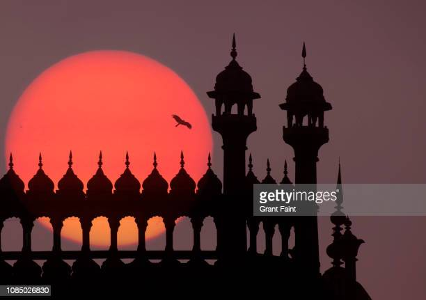 partial view of mosque at sunset. - old delhi stock pictures, royalty-free photos & images