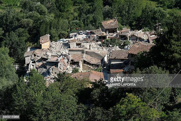 TOPSHOT Partial view of Pescara del Tronto a central Italian village near Amatrice taken on August 26 two day after a 62magnitude earthquake struck...