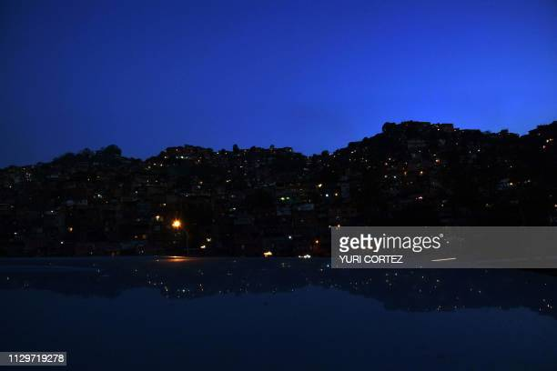 Partial view of the Alcabala neighborhood on Petare hill where electric power has been restored in some sectors of Caracas on March 10 during the...