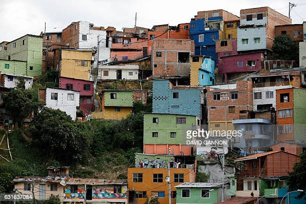 Partial view of the Comuna 13 shantytown in Medellin Colombia on January 13 2017 / AFP / David GANNON