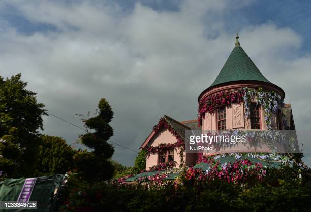 Partial view of the house in The Burnaby area of Greystones which has been covered from the roof down by stretched pink flowers and trellis-style...