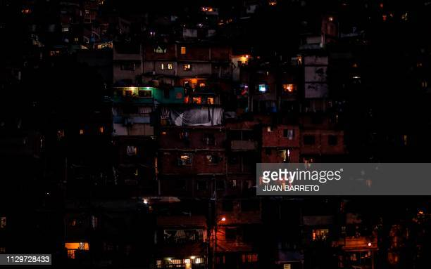 TOPSHOT Partial view of the neighborhood Petare hill where electric power has been restored on March 10 during the third day of a massive power...