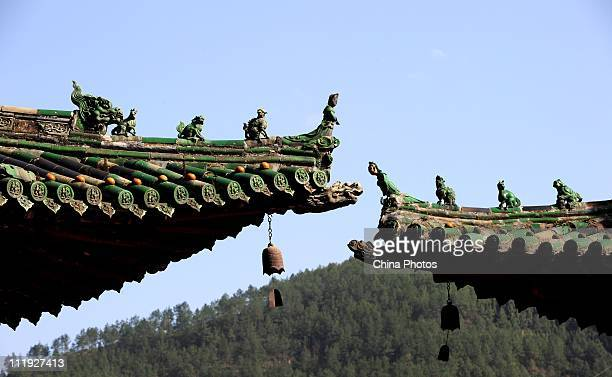 A partial view of the palace eaves of Baoen Temple destroyed during the 2008 earthquake on April 9 2011 in Pingwu County of Mianyang Sichuan Province...