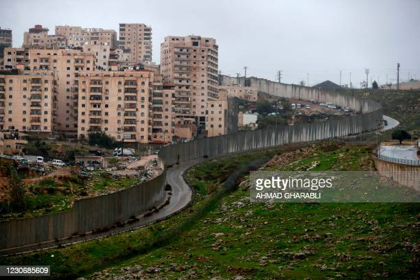 Partial view of the Palestinian refugee camp of Shuafat in east Jerusalem on January 20, 2021 where tens of thousands Palestinians live enclosed by...