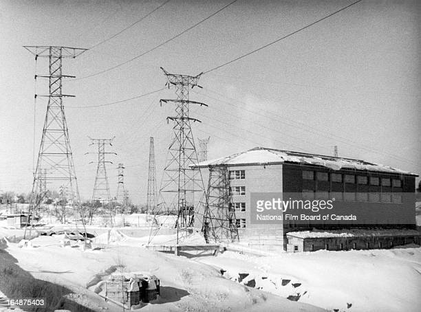 Partial view of the Shawinigan hydroelectric power station surrounded by transmission towers, Shawinigan, Quebec, Canada, 1951. Photo taken during...