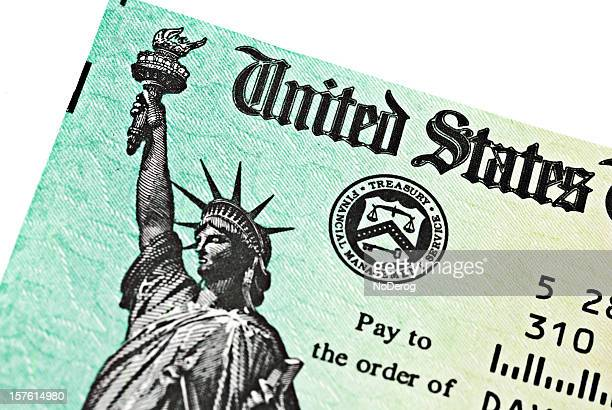 partial view of us treasury irs refund check - irs stock pictures, royalty-free photos & images