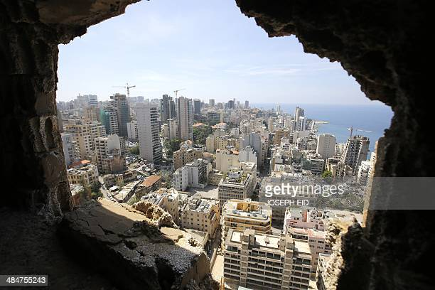 A partial view of west Beirut' suburbs is seen from a sniper hole in the Holiday Inn hotel in the Lebanese capital on April 11 2014 AFP PHOTO/JOSEPH...