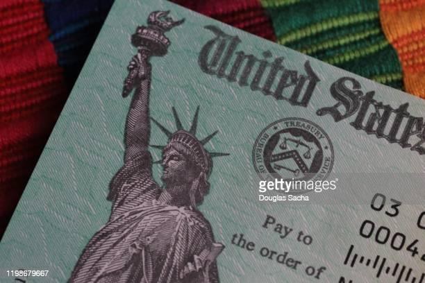 partial view on a us treasury payment check - irs stock pictures, royalty-free photos & images
