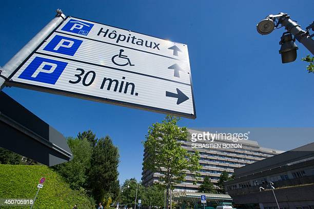 Partial view shows a sign board in front of the CHUV hospital in Lausanne on June 16 where Formula One champion and former pilot Michael Schumacher...