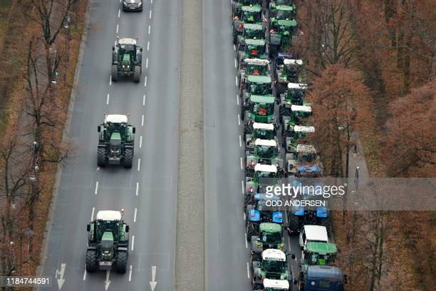 Partial view shows hundreds of farmers lining up with their tractors along Strasse des 17 Juni Avenue towards Brandenburg Gate during a protest on...