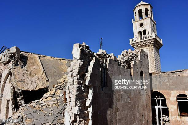 A partial view shows the damaged Forty Martyrs Armenian Apostolic Cathedral in old Aleppo's Jdeideh neighbourhood on December 9 2016 Syria's...