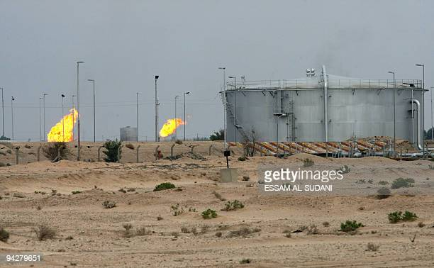 A partial view shows the Iraqi oil refinery of alZubair 30kms south of the southern Iraqi port city of Basra December 11 2009 Iraq struck deals with...