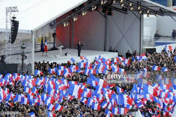A partial view taken on April 15 2012 shows supporters attending a campaign meeting of France's incumbent President and UMP ruling party's candidate...