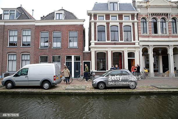 Partial view taken on November 19 2015 of the Fleming Street in Delft shows the original location of the world famous painting Little Street by the...