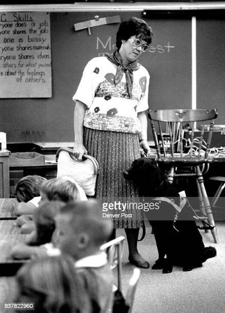 Partially Blind teacher Marge West with her seeing eye dog Rush waits to leave her first grade classroom for lunch on first day of school Credit The...
