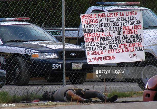 A partially charred body lies outside the police station in Ciudad Juarez Chihuahua state Mexico on November 10 2008 A banner signed by el Chapo...