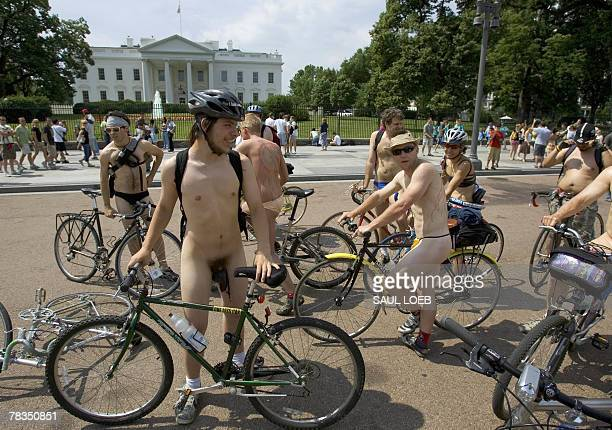 Partially clad demonstrators pause in front of the White House in Washington DC 09 June 2007 as part of the World Naked Bike Ride Nude cyclists are...