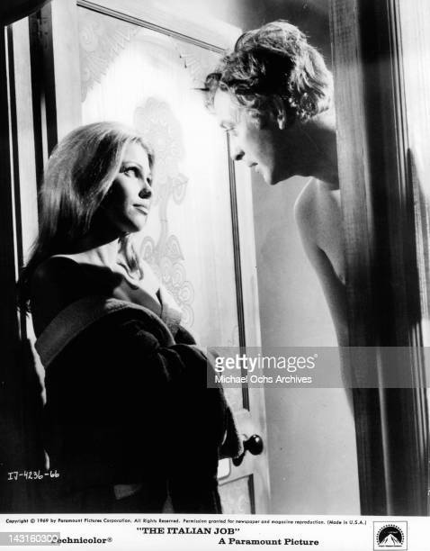 Partially clad Margaret Blye looking up at Michael Caine in a scene from the film 'The Italian Job' 1969