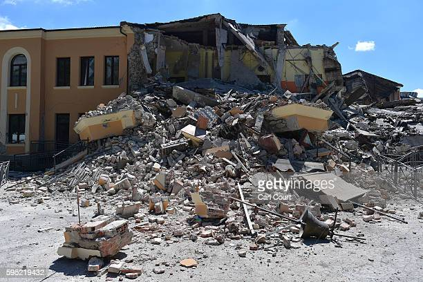 A partially collapsed school that was built after the introduction of antiearthquake construction legislation is surrounded by rubble on August 25...