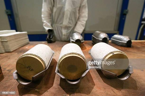 Partially completed automobile catalytic converter emission control devices that contains platinum sit on a table at BM Catalysts in Mansfield UK on...