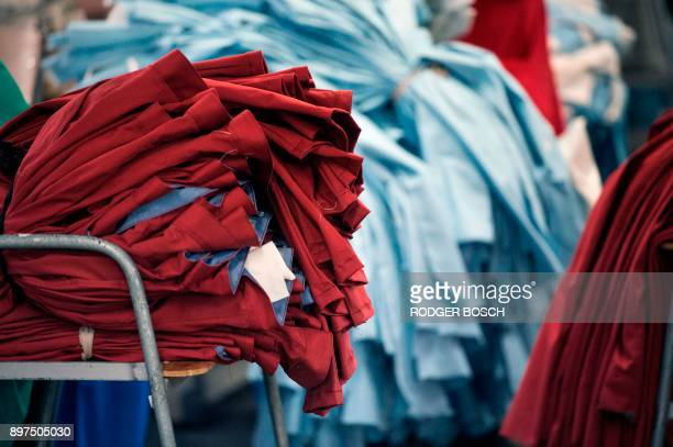 Partially completed men's trousers lie piled up at Kinross Clothing manufacturers in Maitland on October 19 in Cape Town South Africa is fighting to...