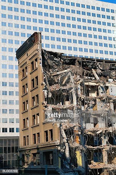 Partially demolished old building, office building in background