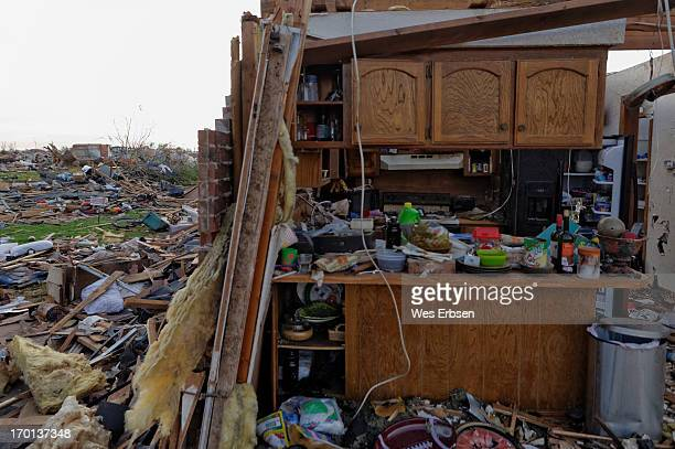 CONTENT] Partially destroyed home in Moore OK shows kitchen interior contrasted against complete devastation in the neighborhood