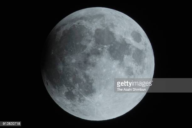 A partially eclipsed super blue blood moon is seen on January 31 2018 in Tokyo Japan