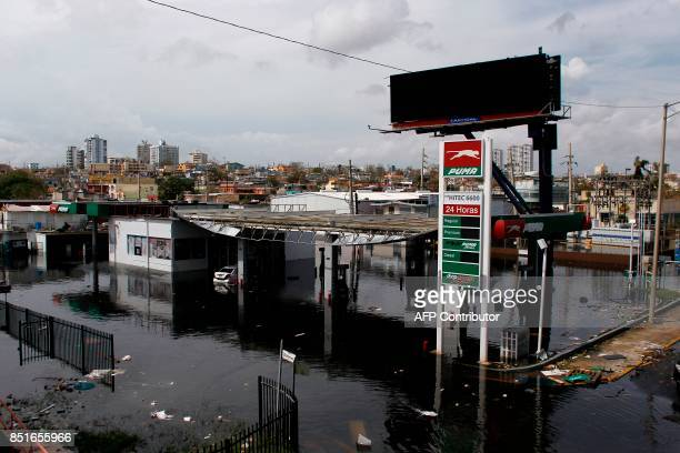 A partially flooded gas station is seen in the aftermath of Hurricane Maria in San Juan Puerto Rico on September 22 2017 Puerto Rico battled...