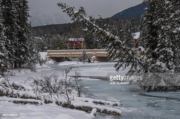 Partially frozen Bow River makes its way through the Alberta's Banff National Park in Lake Louise the host of men's alpine skiing FIS World Cup in...