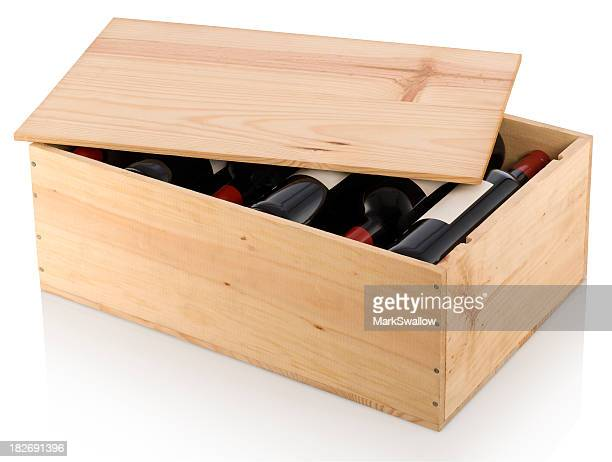 A partially opened wooden box full of red wine