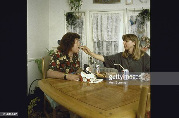 Partially paralyzed singer/songwriter Jan Berry , former member of '60s surf-rock duo Jan & Dean, being fed in the kitchen by his wife Gertie Filip...