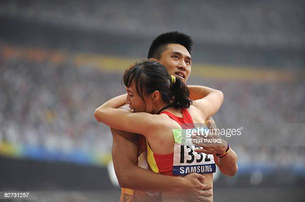 Partially sighted runner Wu Chunmiao of China reacts after winning gold with her guide in the final of the 100m T11 final A during the 2008 Beijing...