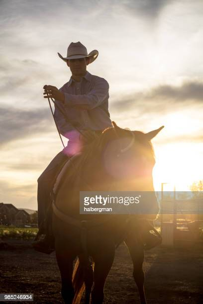 Partially Silhouetted Cowboy at Sunset