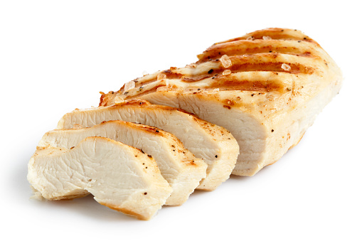Partially sliced grilled chicken breast with black pepper. 643362510