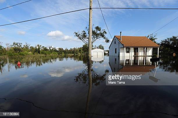 A partially submerged home stands in Hurricane Isaac's flood waters on September 1 2012 in Braithwaite Louisiana Louisiana residents continue to cope...