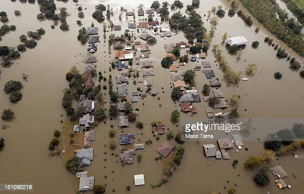 Partially submerged homes are seen in Hurricane Isaac's flood waters after a levee breach on August 31 2012 in Braithwaite Louisiana Louisiana...