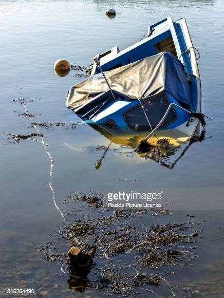 a partially sunk boat - wreck stock pictures, royalty-free photos & images