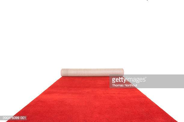 partially unrolled red carpet - red carpet event stock pictures, royalty-free photos & images