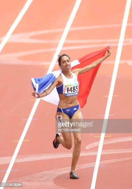 Partially-sighted runner Assia El'Hannouni of France celebrates winning gold in the women's 400m T12 final event during the 2008 Beijing Paralympic...