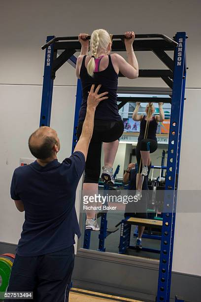 Partially-sighted skiing paralympian from the Sochi Olympics, Kelly Gallagher trains with her trainer in the gym at the Sports Institute, University...