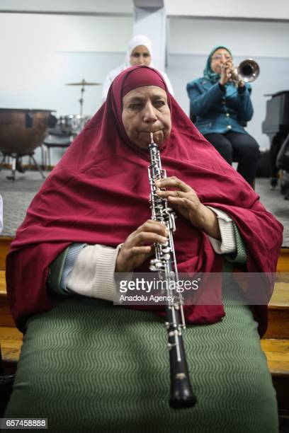 Partiallysighted women use musical instruments as they receive music education in Cairo Egypt on March 24 2017