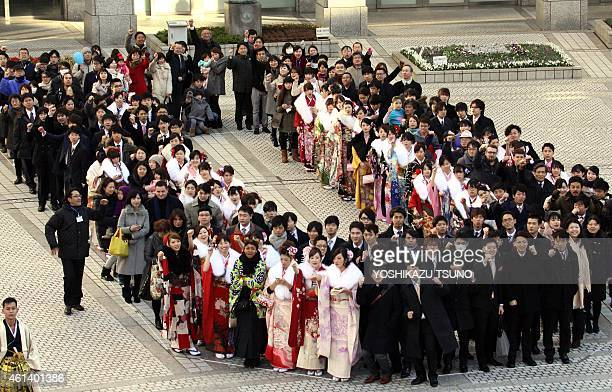 Particapants gather on the forecourt of the Tokyo Metropolitan Assembly building in Tokyo on January 12 2015 to collectively form a zero of the...
