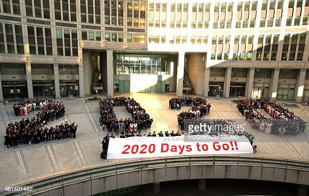 Particapants gather on the forecourt of the Tokyo Metropolitan Assembly building in Tokyo on January 12 2015 to collectively form the number '2020'...