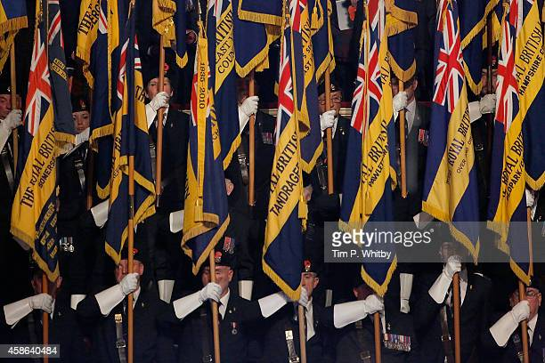 Particiapnts hold up flags during The Royal British Legion's Festival of Remembrance at Royal Albert Hall on November 8 2014 in London England