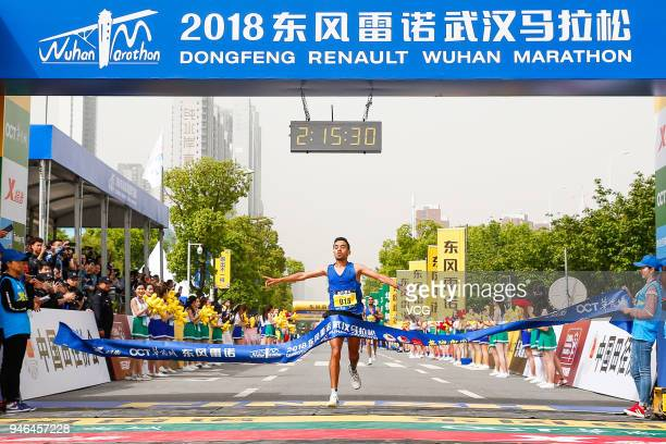 A participant arrives at finishing line during the 2018 Dongfeng Renault Wuhan Marathon on April 15 2018 in Wuhan Hubei Province of China