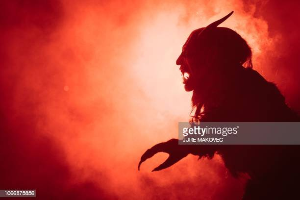 A participant as dressed Krampus a halfgoat halfdemon figure that punishes people who misbehaved during Christmas season takes part in The Hike of...
