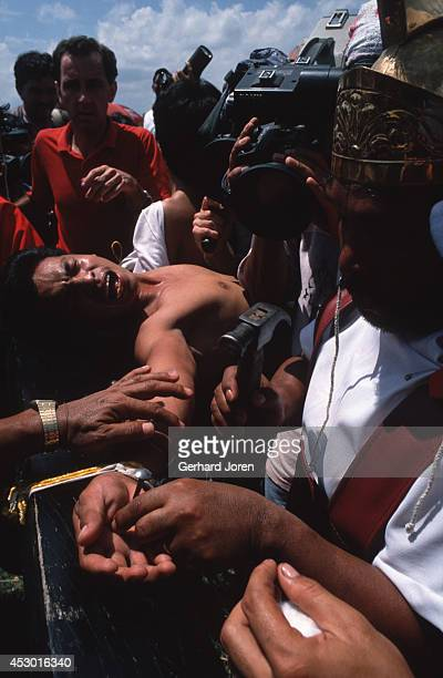 A participant at a crucifixion on Good Friday in the Cutud district of San Pedro town 80 kilometres north of Manila The crucifixion which draws large...