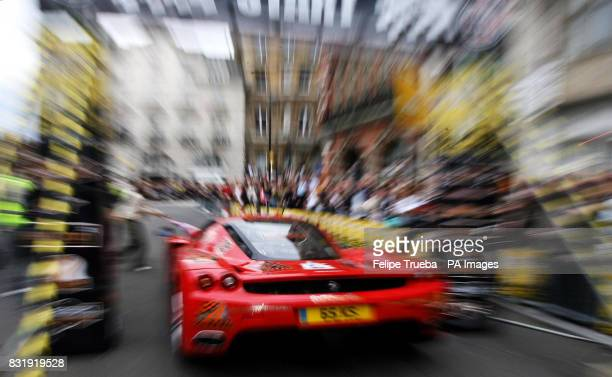A participant at the start of the car rally Gumball 3000 in Pall Mall in London